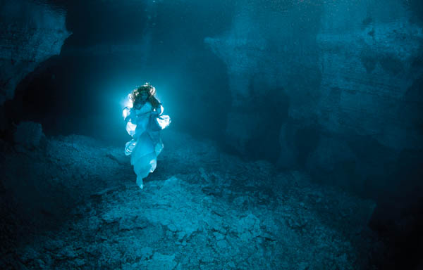 The  Lady Of The Cave: Legend and myth imbue Russia's Ural Mountains, home to the Orda Cave and its resident, a beautiful spirit that embodies the beauty that surrounds her. It's said she watches over divers who enter the cave, provided their intentions are pure. She proves elusive so former free diving champion Natalia Avseenko volunteered to model for this 2011 shoot, posing as the Lady of the Cave at depths to 56 feet (17m). Photography by Victor Lyagushkin