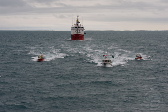 Survey vessels steaming in formation at the conclusion of the successful field project: hydrographic survey launches Gannet and Kinglett (right, left), CCGS Sir Wilfrid Laurier (rear), and Parks Canada RV Investigator (foreground). Photo: Thierry Boyer, Parks Canada