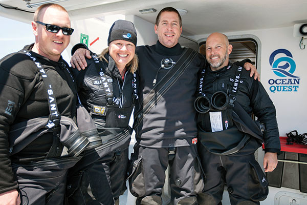 The author (second from left) is often one part of capable dive team, fortunate to venture where few women or men have ever been